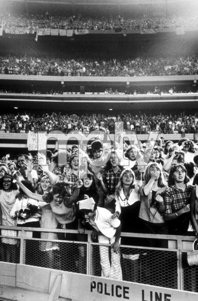 Beatles Fans enjoying concert at Shea Stadium, August 15, 1965 © 1978 George E. Joseph / MPTV  - Image 7685_0171