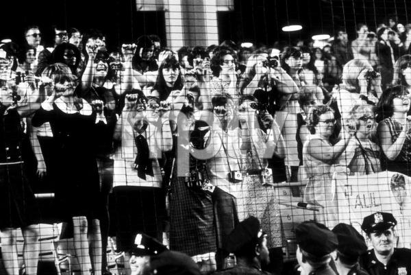 Beatles Fans enjoying concert atShea Stadium, August 15, 1965(fans clinging onto wire fences) © 1978 George E. Joseph / MPTV - Image 7685_0181