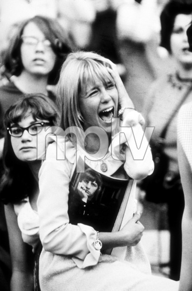 Beatles Fan enjoying concert at Shea Stadium, in tears of extreme joyholding a program, August 15, 1965 © 1978 George E. Joseph / MPTV - Image 7685_0182