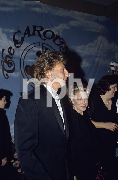 """Barry Manilow with Bette Midler at """"Carousel of Hope Ball"""" at the Beverly Hilton Hotel1990 © 1990 Gunther - Image 7701_0030"""