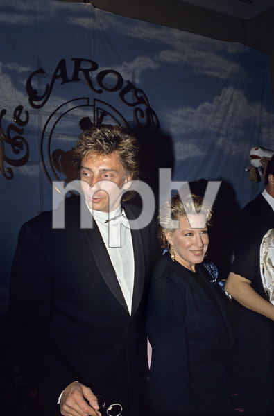 """Barry Manilow with Bette Midler at """"Carousel of Hope Ball"""" at the Beverly Hilton Hotel1990 © 1990 Gunther - Image 7701_0031"""