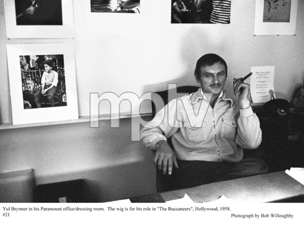 """""""The Buccaneer"""" Yul Brynner sitting in his Paramount Studios office during filming, 1958 Paramount © 1978 Bob Willoughby - Image 9011_0003"""