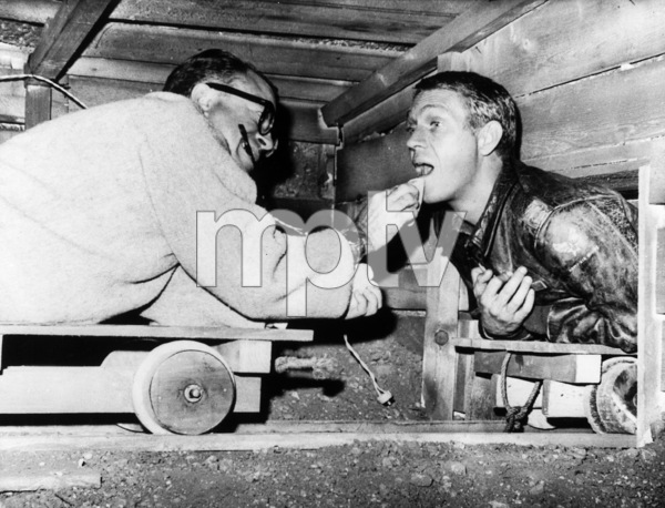 """The Great Escape""Make up man Emile Lavigne making Steve McQueen dirtier for the next take1963U/A - Image 9429_0013"
