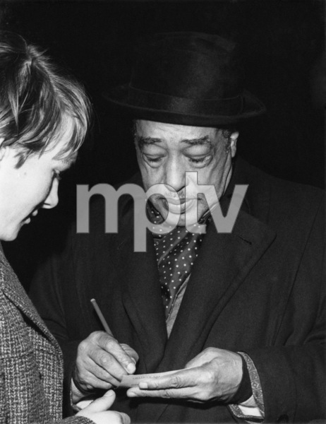 Duke Ellington signing his autograph circa 1962Photo by Brian Foskett © National Jazz Archive - Image FOS_00246